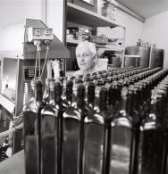 Arnaud busy bottling the oil