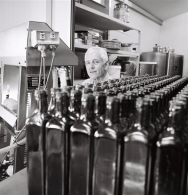 Arnaud busy bottling the oil
